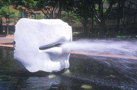 spitting: Modern art sculpture of mouth spitting water, Alexandria Virginia, Washington D.C.