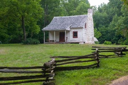 White log cabin and log fence in Orange County, Virginia near Charlottesville, VA