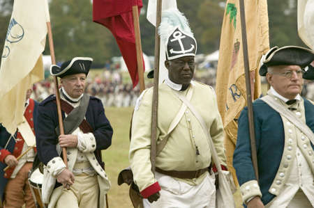 African American from the 1st Rhode Island Regiment at the 225th Anniversary of the Victory at Yorktown, a reenactment of the siege of Yorktown, where General George Washington commanded 17,600 American troops and French Comte de Rochambeau lead 5500 Fren