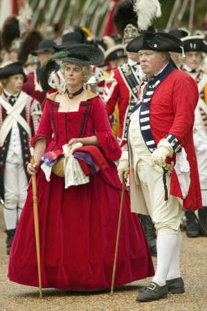 British officer and lady in red dress watch with disdain the British surrender to General George Washington at the 225th Anniversary of the Victory at Yorktown, a reenactment of the siege of Yorktown, where General George Washington commanded 17,600 Ameri