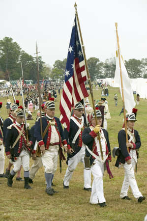 commanded: Patriot soldiers march to Surrender Field as part of the 225th Anniversary of the Victory at Yorktown, a reenactment of the siege of Yorktown, where General George Washington commanded 17,600 American troops and French Comte de Rochambeau lead 5500 French Editorial