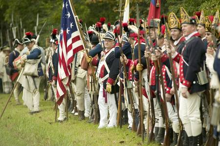 American Patriot soldiers line Surrender Road at the 225th Anniversary of the Victory at Yorktown, a reenactment of the siege of Yorktown, where General George Washington commanded 17,600 American troops and French Comte de Rochambeau lead 5500 French tro