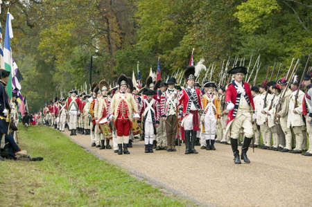 commanded: British Musicians march at Surrender Field at the 225th Anniversary of the Victory at Yorktown, a reenactment of the siege of Yorktown, where General George Washington commanded 17,600 American troops and French Comte de Rochambeau lead 5500 French troops