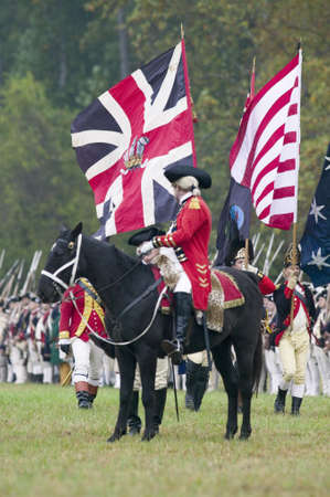 commanded: General Charles OHara with British flags surrenders to General George Washington at the 225th Anniversary of the Victory at Yorktown, a reenactment of the siege of Yorktown, where General George Washington commanded 17,600 American troops and French Comt Editorial