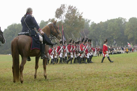 commanded: General George Washington salutes British column as they pass at the 225th Anniversary of the Victory at Yorktown, a reenactment of the siege of Yorktown, where General George Washington commanded 17,600 American troops and French Comte de Rochambeau lead Editorial
