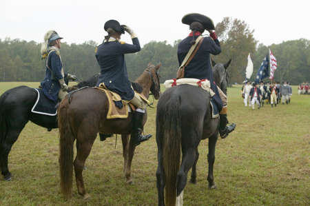 commanded: General George Washington and staff prepare to salute column of Continental Patriot troops at Surrender Field at the 225th Anniversary of the Victory at Yorktown, a reenactment of the siege of Yorktown, where General George Washington commanded 17,600 Ame