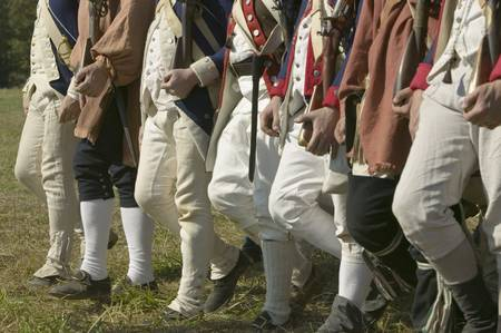 civil war: Continentals on the march in re-enactment of Attack on Redoubts 9 & 10, where the major infantry action of the siege of Yorktown took place. General Washingtons armies captured two British fortifications, Endview Plantation (circa 1769), near Yorktown Vi Editorial