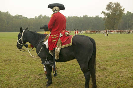 commanded: General Charles OHara on horseback surrenders to General George Washington at the 225th Anniversary of the Victory at Yorktown, a reenactment of the siege of Yorktown, where General George Washington commanded 17,600 American troops and French Comte de R