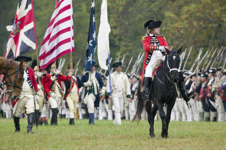 regiment: General Charles OHara with British flags surrenders to General George Washington at the 225th Anniversary of the Victory at Yorktown, a reenactment of the siege of Yorktown, where General George Washington commanded 17,600 American troops and French Comt Editorial