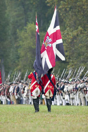 British flag and British troops at Surrender Field at the 225th Anniversary of the Victory at Yorktown, a reenactment of the siege of Yorktown, where General George Washington commanded 17,600 American troops and French Comte de Rochambeau lead 5500 Frenc