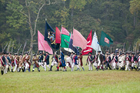 def: Continental regimental flags at the 225th Anniversary of the Victory at Yorktown, a reenactment of the siege of Yorktown, where General George Washington commanded 17,600 American troops and French Comte de Rochambeau lead 5500 French troops, together def