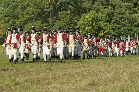 regiment: British on the march in re-enactment of Attack on Redoubts 9 & 10, where the major infantry action of the siege of Yorktown took place. General Washingtons armies captured two British fortifications, Endview Plantation (circa 1769), near Yorktown Virgini