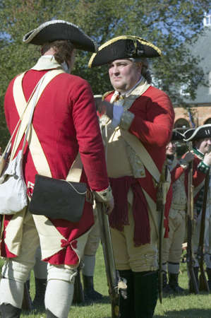 British soldiers toast to the King of England in front of the Digges House, built in 1775 in Yorktown, Virginia. First owner Dudley Digges house now resides in the Colonial National Historical Park, Historical Triangle, as part of the 225th anniversary o Editorial