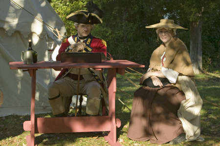 american revolution: British Officer and his wife sit in Yorktown, Virginia, as part of the 225th anniversary of the Siege of Yorktown, a reenactment of the 1781 defeat of the British Army and the end of the American Revolution.