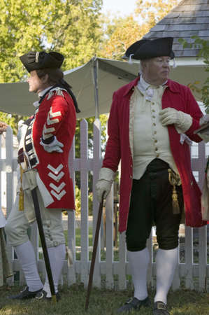 british army: General Charles OHara leans on fence with British Officer in Yorktown, Virginia, as part of the 225th anniversary of the Siege of Yorktown, a reenactment of the 1781 defeat of the British Army and the end of the American Revolution.