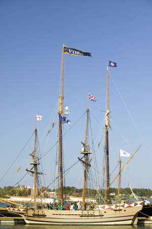 Tallship with Virginia and British flags flying at historic Yorktown, Colonial National Historical Park, Yorktown, Virginia