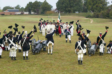 Revolutionary War re-enactors re-create the cannon fire and subsequent cease-fire of the British army, in which they flew the white flag requesting a truce, bringing an end to the bombardment by the Allied armies and beginning the negotiations to surrende