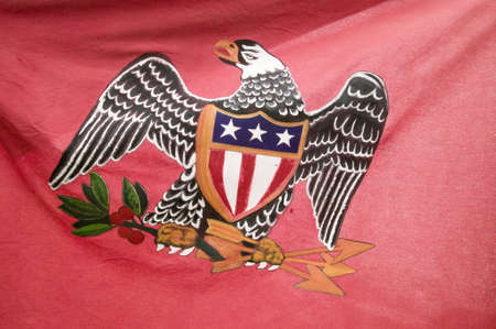 american revolution: Early American patriotic flag with Eagle at the 225th Anniversary of the Siege of Yorktown, Virginia, 1781, ending the American Revolution with the defeat of the British Army and Lord Cornwallis surrendering to General Washington.