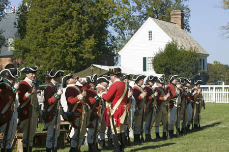 resides: British soldiers toast to the King of England in front of the Digges House, built in 1775 in Yorktown, Virginia. First owner Dudley Digges house now resides in the Colonial National Historical Park, Historical Triangle, as part of the 225th anniversary o Editorial
