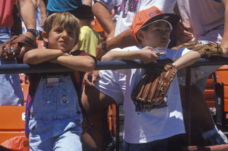 Young baseball fans watching game at Candlestick Park, San Francisco, CA