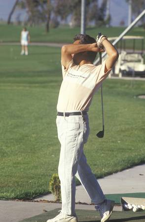 Golfer in mid-swing, Golf Retreat, Santa Clara, CA