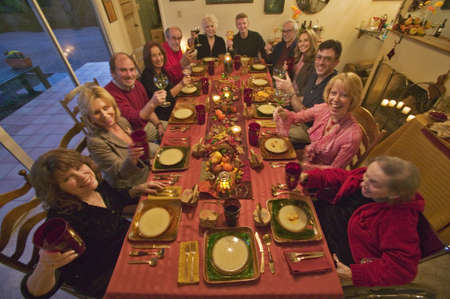 Guests at an elegant Thanksgiving dinner party