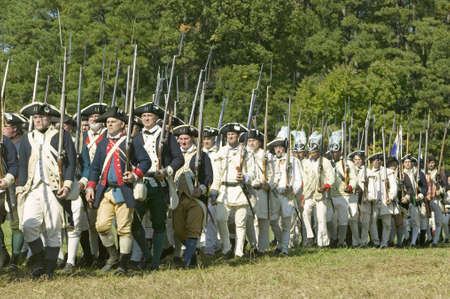 bayonet: Continentals on the march in re-enactment of Attack on Redoubts 9 & 10, where the major infantry action of the siege of Yorktown took place. General Washingtons armies captured two British fortifications, Endview Plantation (circa 1769), near Yorktown Vi Editorial