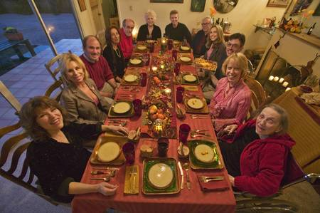 feast: Guests at an elegant Thanksgiving dinner party