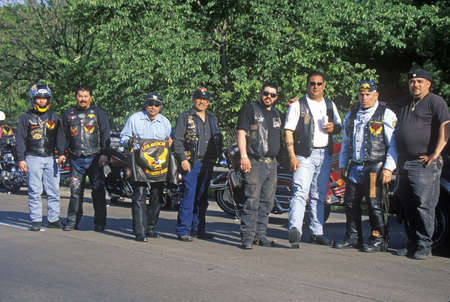 A group of men with their Harley Davidsons from the Latin American Motorcycle Association take a break in Dallas, Texas during their trek from Chicago to Guadalajara
