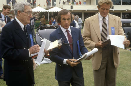chandler: The Scottish race car driver Jackie Stewart, center, and other former racecar drivers judge classic cars at the 35th Annual Concours D Elegance Competition, ca. 1985 Editorial