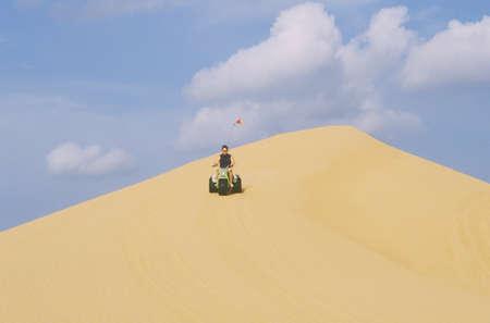 three wheeler: A three wheeler dune buggy rides in Little Sahara State Park in Oklahoma