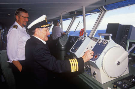 The captain of the ferry Bluenose  piloting his boat as a navigator stands by, Yarmouth, Nova Scotia Editorial