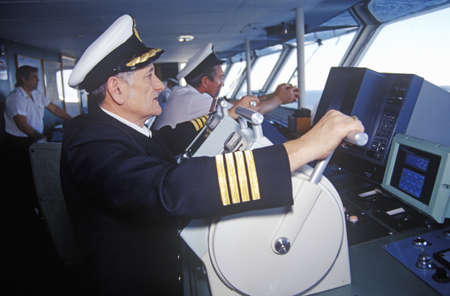 The captain of the ferry Bluenose piloting the ship through the waters between Maine and Nova Scotia