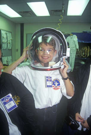 flight helmet: Children try on $1 million spacesuit at Space Camp, George C. Marshall Space Flight Center, Huntsville, AL