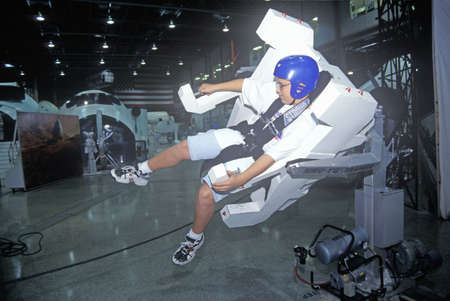 maneuvering: A boy attending space camp at the George C. Marshall Space Flight Center in Huntsville, Alabama, tries a MMU 1-G Trainer Editorial