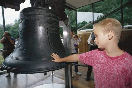 liberty bell: Boy putting his hand on Liberty Bell Editorial