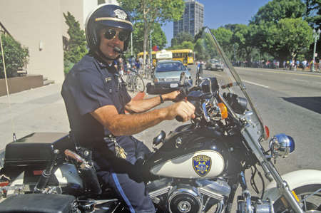 oakland: Oakland policeman poses on his motorcycle in Oakland, California