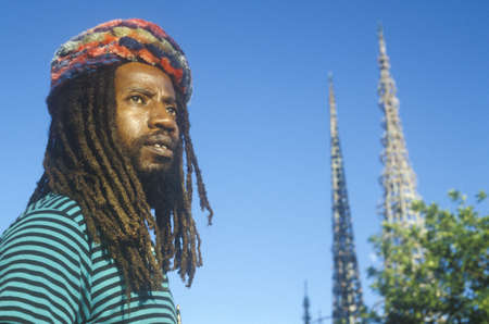riots: African American male poses with the Watts Towers, 20th Anniversary of the 1965 riots, Los Angeles, California