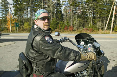 Motorcycle Harley driver looks into camera, Acadia National Park, Maine