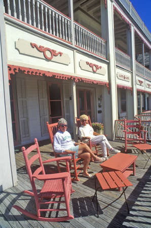 Rocking chairs on porch of Victorian home, Sea Mist Apartments in Cape May, NJ