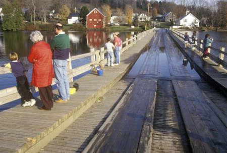 sunset lake: People walking on Brookfield Floating Bridge over Sunset Lake, Brookfield, VT Editorial