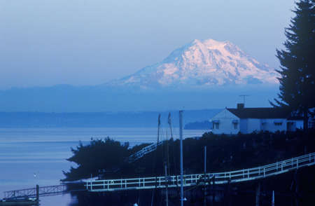 snowcapped: Snow-capped Mt. Rainier, from Seattle, WA Editorial