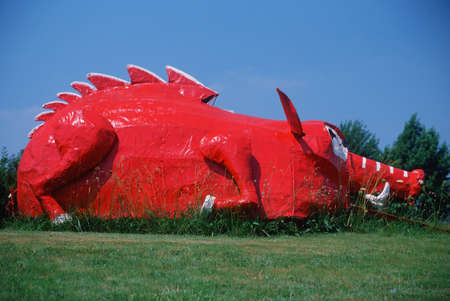 Roadside attraction of metal sculptured red dinosaur, Berryville AR Editorial