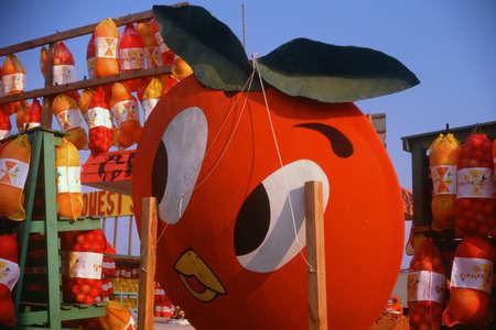 roadside stand: A large orange sign at roadside fruit stand, Southern FL