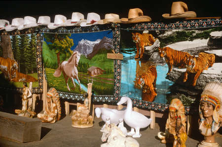roadside stand: Carpets, cowboy hats and ceramics for sale at a roadside stand, San Joaquin CA Editorial