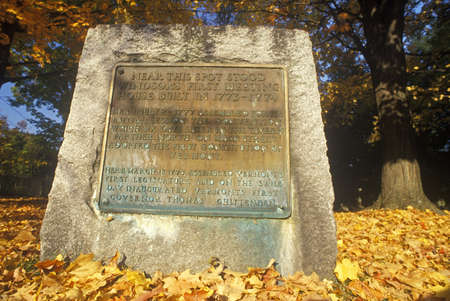 Stone and plaque marking founding of Windsor, VT in autumn
