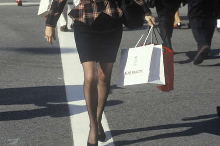A well dressed woman with shopping bags, Beverly Hills, CA Editorial