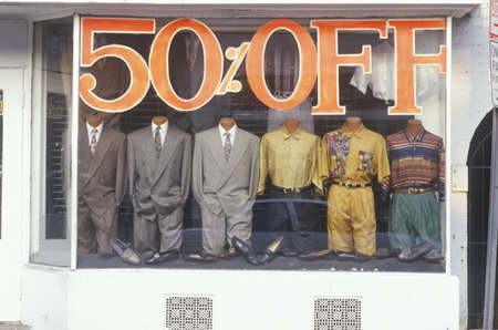 Discounted mens clothes in storefront window, Georgetown, Washington D.C.