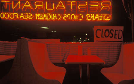 advertise with us: Window booth of a diner in neon lights
