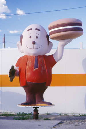 advertise with us: Mascot for a hamburger stand, Bowie, AZ Editorial
